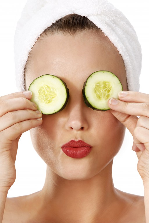 Spa: Young Woman With Cucumbers on Eyes