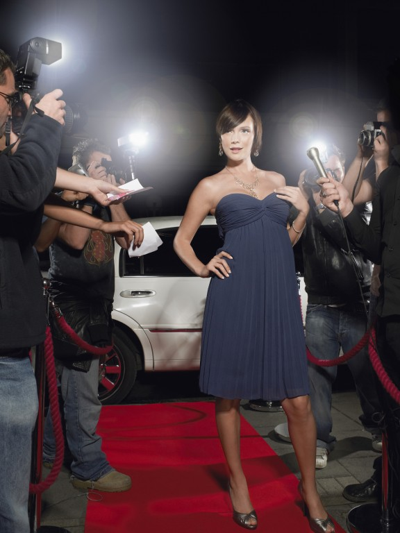 Woman Posing On Red Carpet Being Photographed By Paparazzi