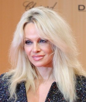 U.S. actress Pamela Anderson arrives on the red carpet for the Bambi 2015 media awards ceremony in Berlin, Germany November 12, 2015. The annual Bambi awards honour celebrities from the world of entertainment, literature, sports and politics. REUTERS/Stefanie Loos