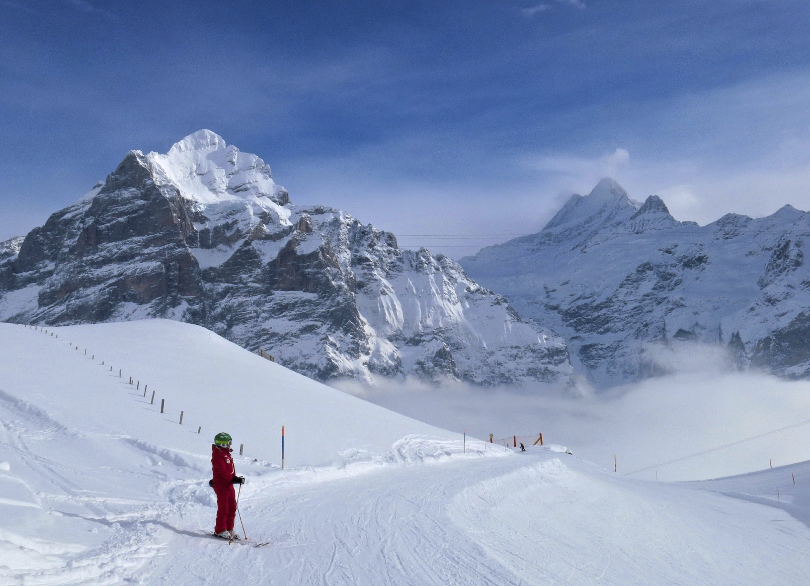 Laura Bomio, my instructor, surveys a blue diamond run at Grindelwald First.