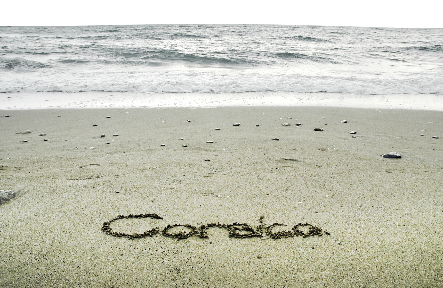 Corsica written in sand on the beach