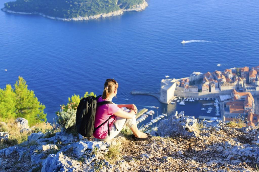tourist enjoying scenic view hiking in Europe, Croatia