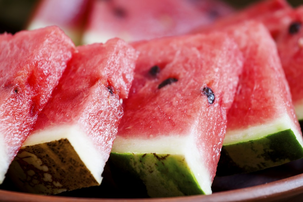 Watermelon slices on a clay plate, selective focus