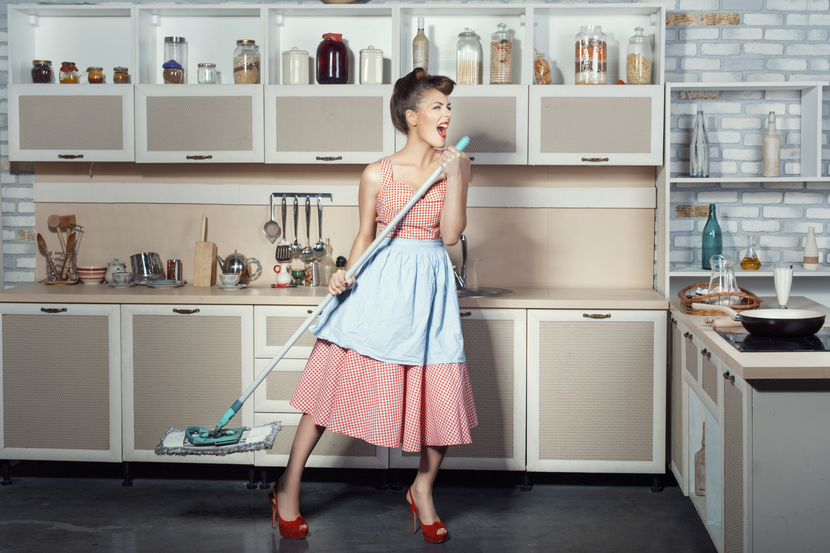 Woman sings and cleans the house.