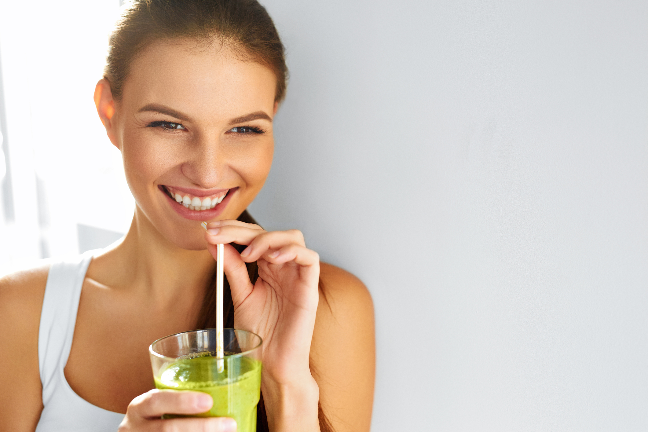 Healthy Food Eating. Woman Drinking Smoothie. Diet. Lifestyle. Nutrition