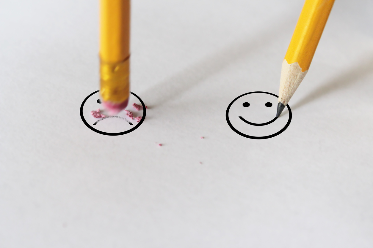 sadness to happiness wit pencil eraser