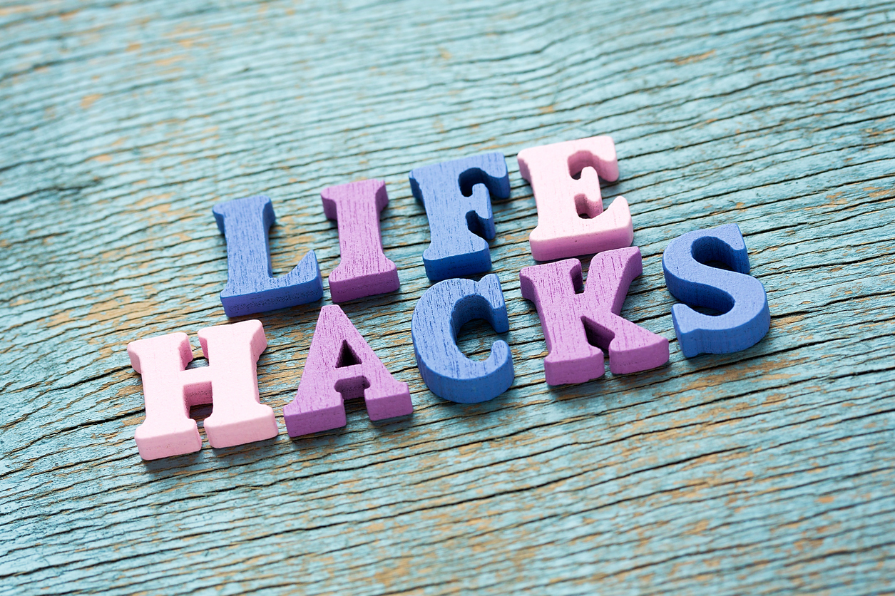 Life hacks phrase made of wooden colorful letters on vintage background