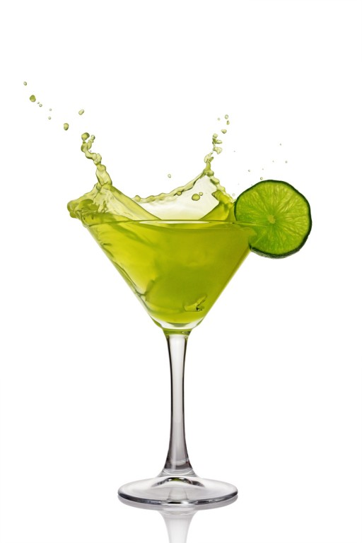 Splash in glass of green alcoholic cocktail